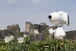 An image of Snoopy stood in front of Caerphilly Castle
